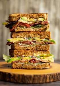 3 sandwich halves stacked on each other with filling showing