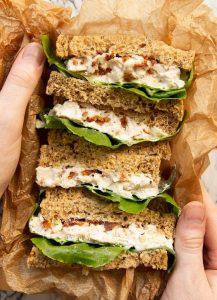 overhead shot of 4 sandwich halves in lunchbox showing filling