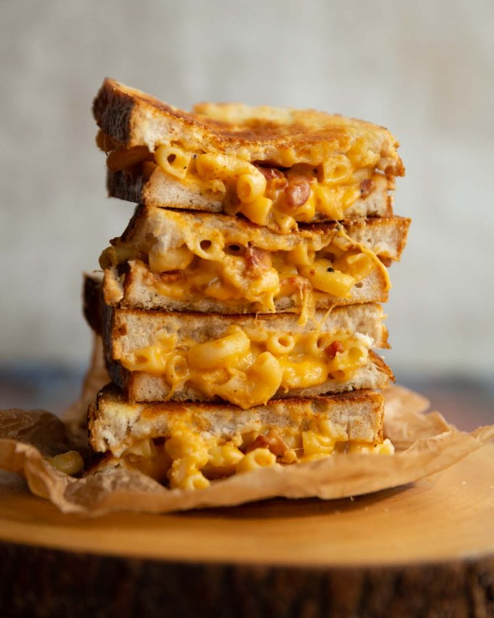 4 sandwich halves stacked on each other with mac and cheese spilling out