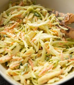 close up shot of coleslaw in large white bowl