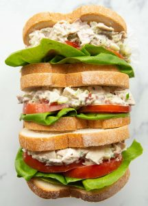 overhead shot of 3 sandwiches stuffed inside rectangle box showing filling