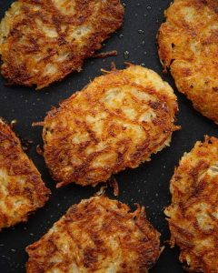 overhead shot of cooked hash browns in frying pan