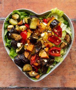 overhead shot of salad in heart shape salad bowl