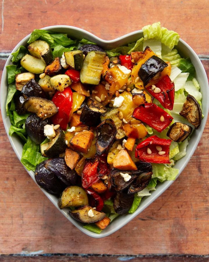 overhead shot of salad in heart shape salad bowl