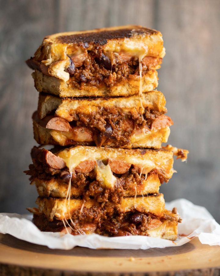 4 sandwich halves stacked on each other will chili spilling out
