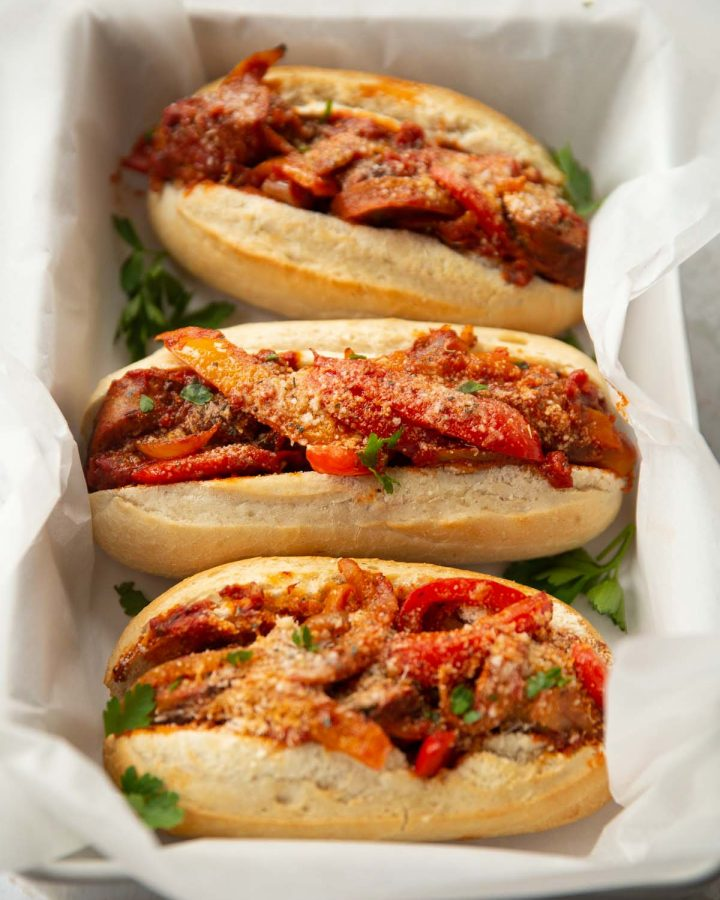 3 sandwiches in arge dish with white parchment paper