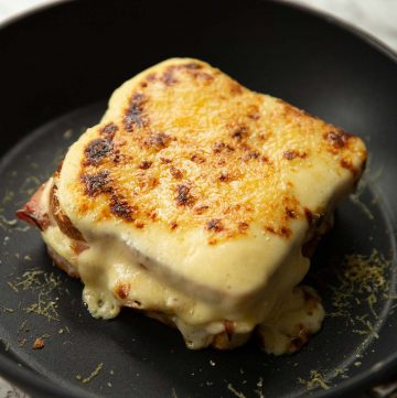 croque monsieur in a small pan fresh out the girll