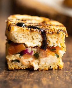 close up shot of half of bruschetta sandwich showing filling