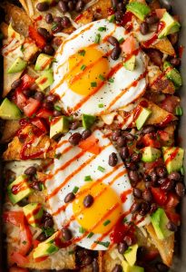 overhead shot of breakfast nachos fresh out the oven