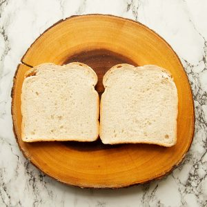 overhead shot of two slices of bread on wooden board