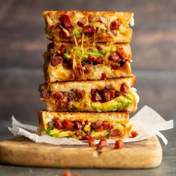 4 sandwich halves stacked on each other with chorizo crumbling out