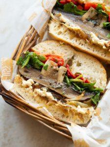 close up shot of half a portbello mushroom sandwich showing filling